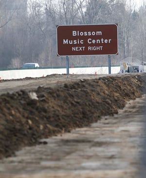 A sound wall is being constructed along Rt. 8 Wednesday, Jan. 13, 2021 in Stow, Ohio.  [Karen Schiely/Beacon Journal]