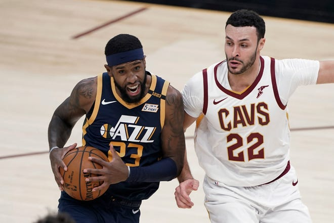 One of the few healthy players on the Cavaliers' roster, forward Larry Nance Jr. (22) has been playing heavy minutes in recent games. [Tony Dejak/Associated Press]