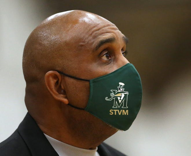 St. Vincent-St. Mary basketball coach Dru Joyce II wanted to be a football coach when he went to Ashland College to play football. [Jeff Lange/Beacon Journal]