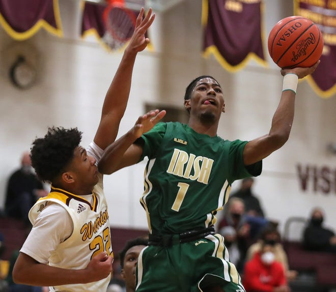 St. Vincent-St. Mary guard Sencire Harris is a strong right-hand man for team leader Malaki Branham for the Fighting Irish. [Jeff Lange/Beacon Journal]