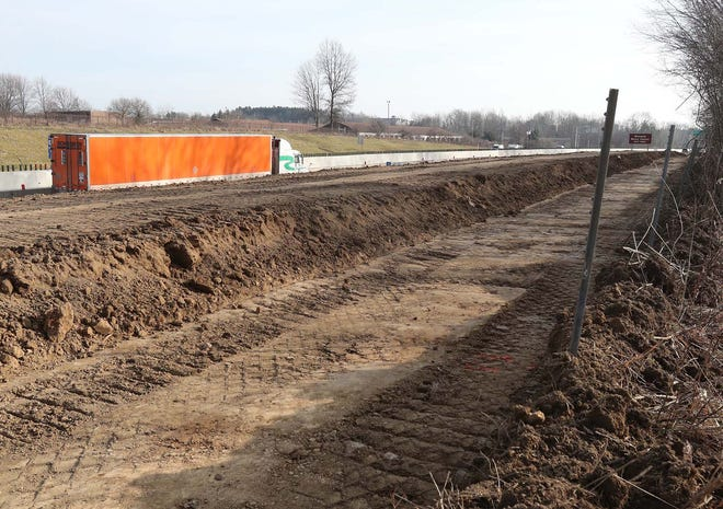 A sound wall is being constructed along Rt. 8 Wednesday, Jan. 13, 2021 in Stow, Ohio.