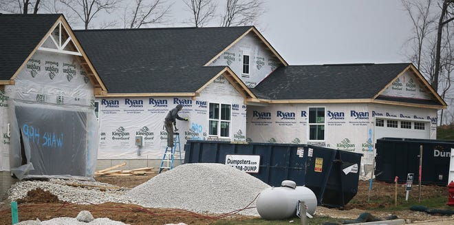 Hundreds of new homes, including this house under construction in January in Lakemore's Hidden Lakes development, have helped to fuel the village's hope to cross the 5,000-resident threshold to become a city, but the 2020 Census showed a population drop instead.
