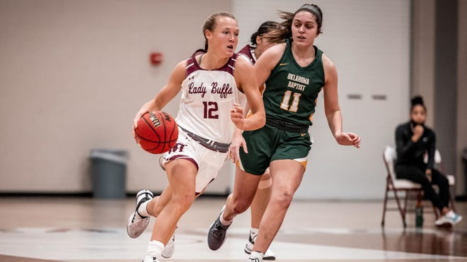 Lady Buffs guard Sienna Lenz drives the ball against Oklahoma Baptist on Tuesday at the First United Bank Center in Canyon. The Lady Buffs won, 74-50.