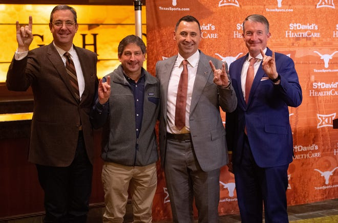 From left, Texas athletics director Chris Del Conte, chairman of the UT System Board of Regents Kevin Eltife and UT president Jay Hartzell welcome new football coach Steve Sarkisian, second from right, to campus at Sarkisian's introductory press conference.