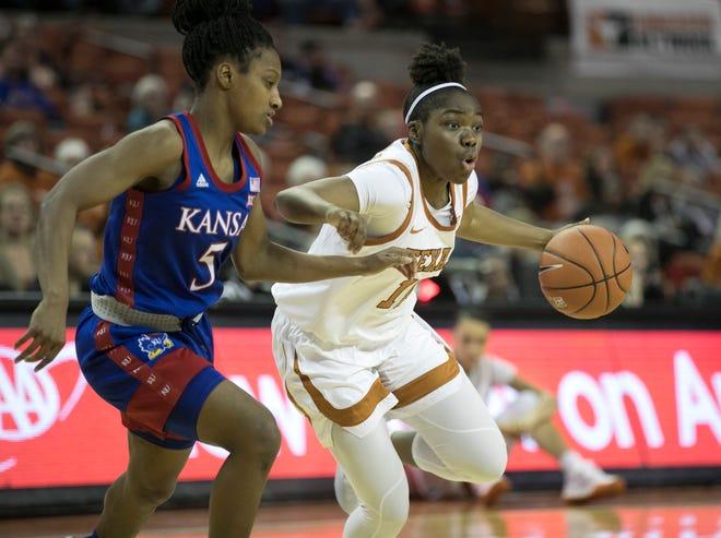 Texas guard Joanne Allen-Taylor drives past Kansas' Aniya Thomas during last season's game at the Erwin Center.