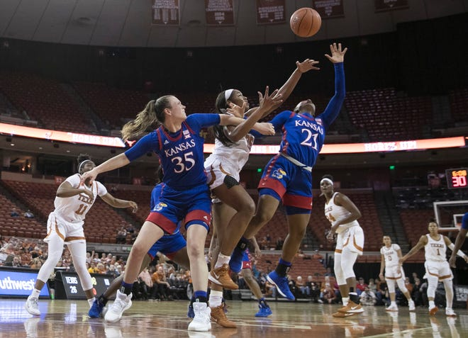 Texas forward Charli Collier fights for a rebound with Kansas' Bailey Helgren, left, and Brooklyn Mitchell during their game last season at the Erwin Center. The teams meet again on Thursday, but no fans will be allowed in because of COVID-19 protocols.