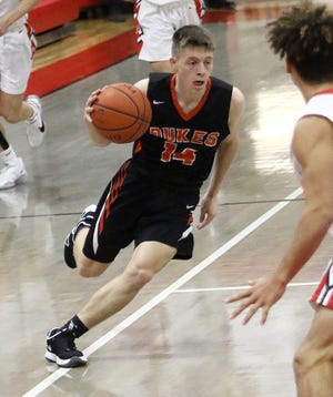Marlington's Casey Miller scored 23 points in the Dukes' loss to Salem on Friday night.
