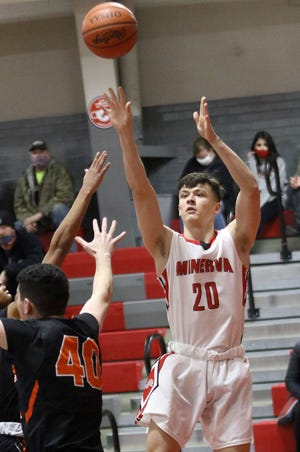 Minerva's Noah Sallade (20) puts up a shot defended by Marlington's Tommy Hippely (40) during conference action at Minerva High School Tuesday, January 12, 2021.