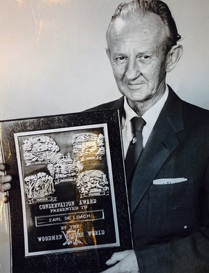 Earl T. DeLoach, outdoors editor of The Augusta Chronicle, with 1957 Woodmen of the World Conservation Award.
