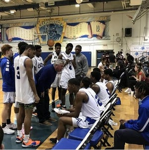 Burlington City High School basketball coach Paul Collins instructs his team during a time out during the team's meeting with Riverside on Feb. 14. Collins earned his 800th career win that night as the Devils won, 70-49.
