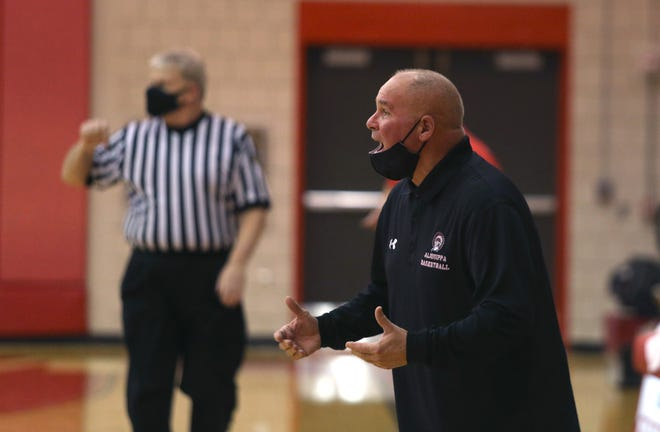 Aliquippa coach Nick Lackovich calls out to his players during the second half against the Freedom Area Bulldogs Tuesday night at Freedom Area High School.