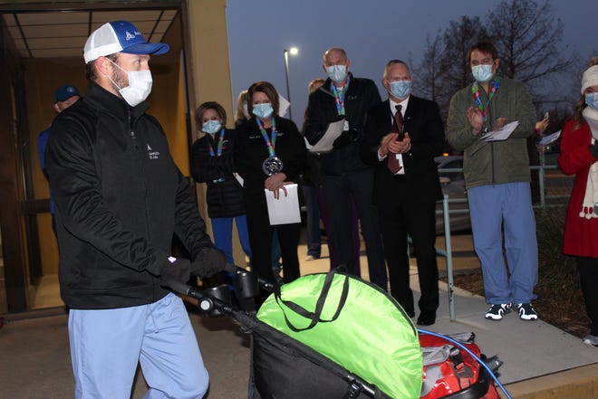 Wyatt Hockmeyer, director of performance improvement for Ascension St. John, starts out on his 46-mile run from Bartlesville's Jane Phillips Medical Center to St. John Medical Center in Tulsa Wednesday to honor frontline workers and their pandemic service.