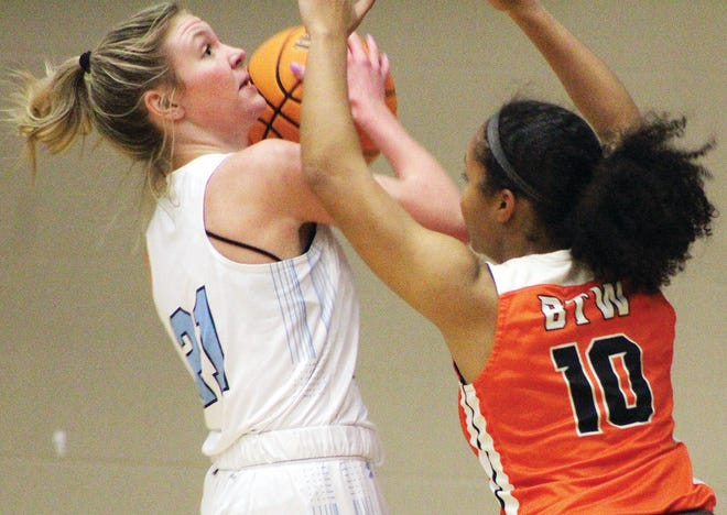Bartlesville High's Payten Pregler, left, faces fierce pressure from a Tulsa Washington defender during girls basketball action Tuesday in Bartlesville