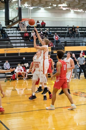 Brendan Parker (middle) goes up for a basket in the 52-47 win over McPherson on Tuesday night inside Hutter Gymnasium. The senior finished with 22 points as Augusta came back from 11 points down to win.