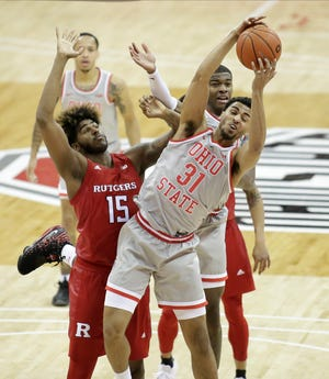 Ohio State Buckeyes forward Seth Towns (31) grabs a rebound away frmo Rutgers Scarlet Knights center Myles Johnson (15) during the second half of Wednesday's NCAA Division I basketball game at Value City Arena in Columbus, Oh. on December 23, 2020.