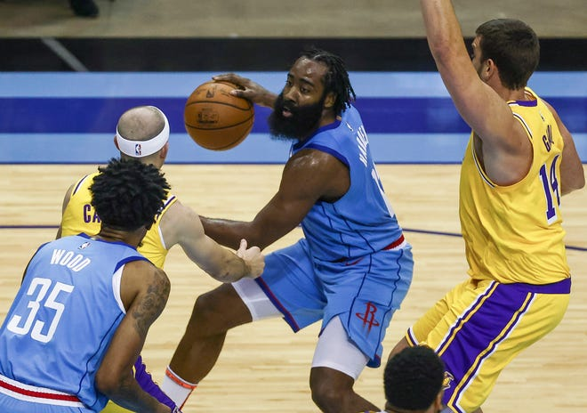Houston Rockets guard James Harden dribbles against the Los Angeles Lakers during Tuesday's game in Houston.