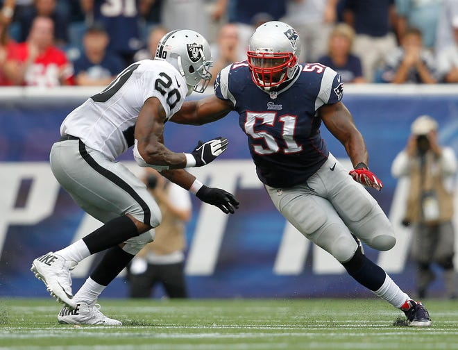New England Patriots middle linebacker Jerod Mayo (51) works against Oakland Raiders running back Darren McFadden (20) blocks during a September 2014 game in Foxboro.