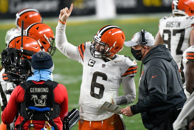 Cleveland Browns offensive coordinator Alex Van Pelt, right, talks with quarterback Baker Mayfield (6) on the sideline during Sunday's NFL wild-card playoff game against the Pittsburgh Steelers in Pittsburgh.