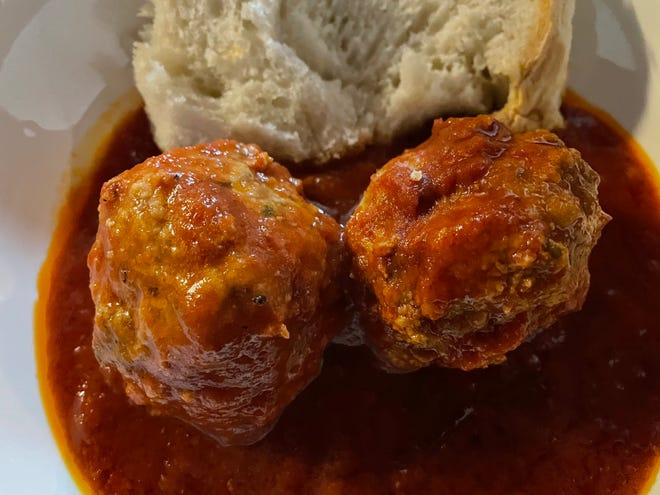A side order of meatballs in sauce with baked-that-day bread from Mezza Luna Restaurant makes the perfect appetizer or lunch. [GWENN FRISS/CAPE COD TIMES]
