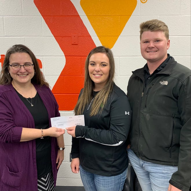 Shawn Hurtgen, Marketing and Outreach Director in charge of BackPack Buddies at the Grand River Area Family YMCA is pictured with Tori Overton and Shayler Keller, Sales Professionals for the Chula Farmer's Cooperative.