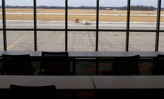 An airplane taxis along the runway at Ohio State University Airport in this 2019 file photo as seen from a classroom at the airport, also known as Don Scott Field.