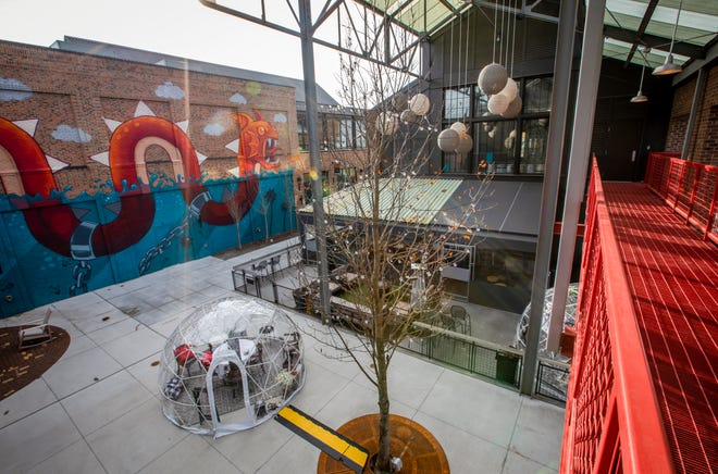 """Businesses around """"The Yard"""" on Easton Town Center's New District are among Easton's newest tenants. The Beeline Bar has set up igloos for eating outside during the winter."""