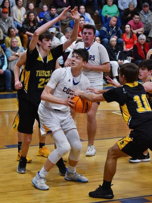 Southwestern Randolph, shown here playing Tuscola in the 2020 3-A state playoffs, opened the season Tuesday with a 65-56 loss to Southern Guilford. [Paul Church photo]
