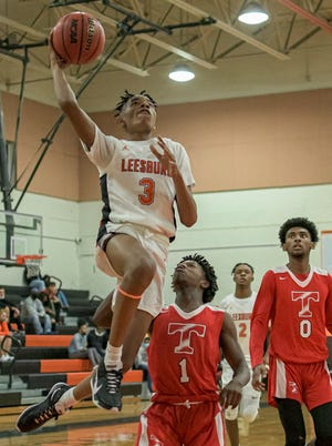 Leesburg's Devin Graham (3) scores two of his six points during Tuesday's game against Tavares at the Hive in Leesburg. a[PAUL RYAN / CORRESPONDENT]
