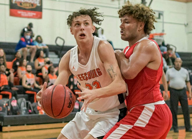 Leesburg's Brandon Barry (23) drives to the basket during Tuesday's game against Tavares at the Hive in Leesburg. [PAUL RYAN / CORRESPONDENT]