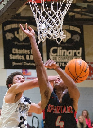 Ledford's Tyler Partee (left), shown here in action against Central Davidson last season, scored 25 points in the Panthers' 82-56 win over South Stokes on Tuesday. [DONNIE ROBERTS/THE DISPATCH]