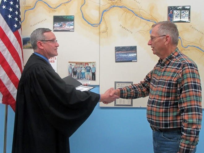 Newly-elected Upper Delaware Council Chairperson Jeffrey R. Dexter of Damascus Township is shown being sworn in last year by the Hon. Steven Sauer, Town Justice for the Town of Cochecton, at the Feb. 6, 2020 UDC meeting.