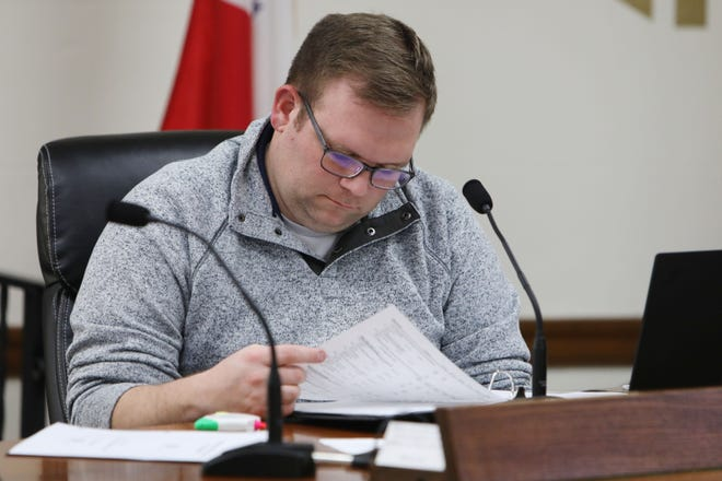 Councilman Matt Rinker looks over an informational binder as interim city manager Jim Ferneau gives the Burlington City Council an overview of the upcoming annual budget for fiscal year 2021-2022, Tuesday Jan. 12, 2021 in the Thomas J. Smith Council Chambers in City Hall.