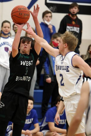 West Burlington High School's Colton Sherwood (1) puts up a shot  during the first half of their game against Danville High School, Tuesday Jan. 12, 2021 at Danville.