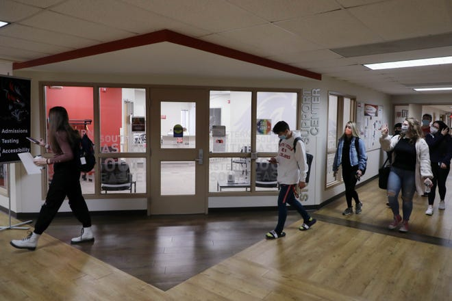 Southeastern Community College students make their way through the hallways between classes Jan. 13 on the West Burlington Campus.