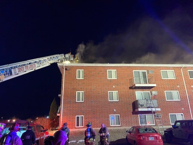 Dover firefighters respond to a fire at the White Cliffs apartments on Martha's Way Tuesday, Jan. 12, 2021.