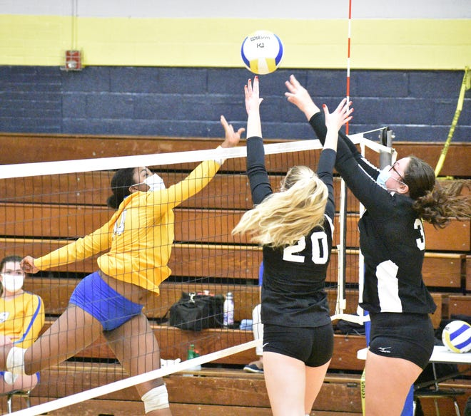 Highland Tech's Ashlynn Stephens tries to get a shot past two Community School of Davidson blockers during Tuesday's first round volleyball playoff match. [JOE L. HUGHES II/Gaston Gazette]