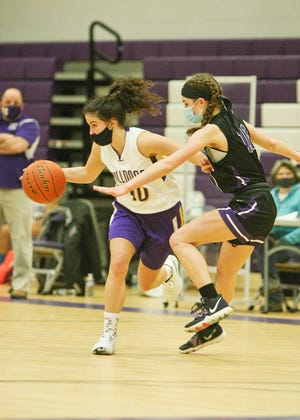With her head coach Scott Malboeuf , left, looking on, Monty Tech's Ashley Femino drives against South Lancaster Academy's Mia DeMartino.