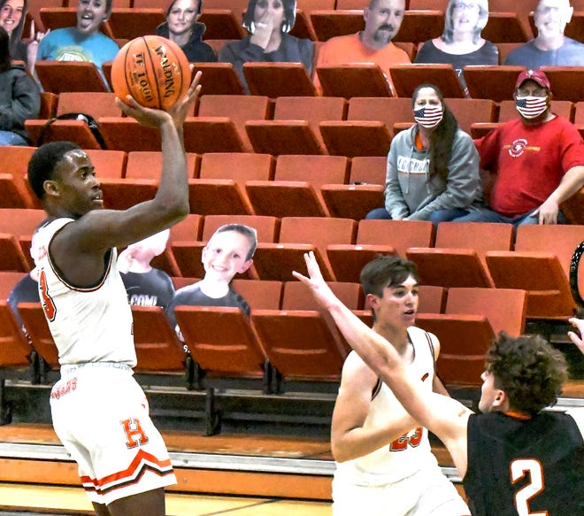 Holcomb's Zephyn Mason goes up for a basket against Ulysses Friday at Holcomb.