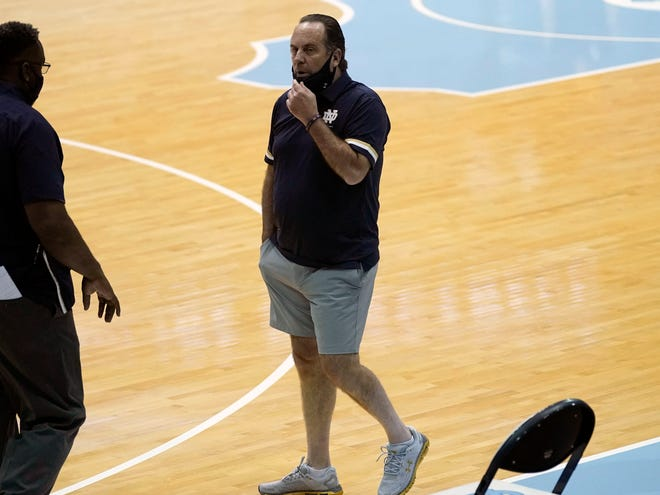 Notre Dame head coach Mike Brey looks on before a game against North Carolina in Chapel Hill, N.C. on Saturday, Jan. 2, 2021. Brey said wanted to loosen up his players, so he put on the gray shorts under his blue polo. (AP Photo/Gerry Broome)