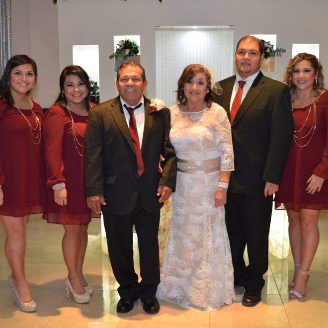 Celebrating over 40 years of marriage, Sabas Ugartecha Jr. and Alicia, wearing her personally designed and crafted gown, with their children, from left Sandra Vaughn, Cindy Herring, Sabas Ugartecha III, and Claudia Kloosterman.