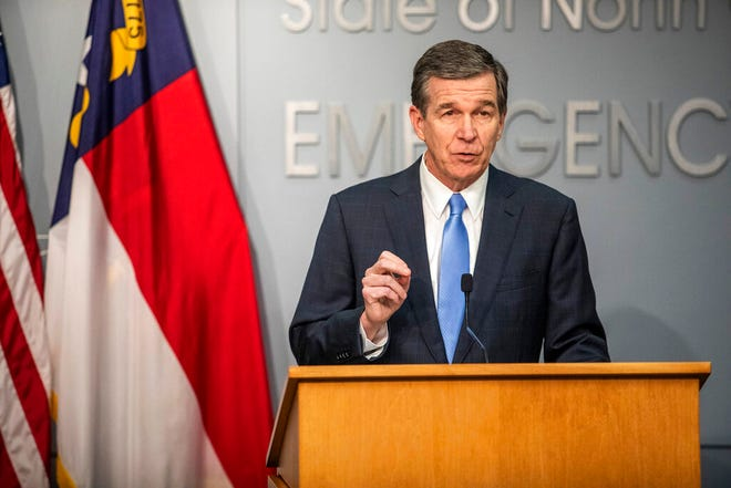 Gov. Roy Cooper speaks during a briefing on North Carolina's coronavirus pandemic response at the N.C. Emergency Operations Center, Jan. 12 in Raleigh. (Travis Long/The News & Observer via AP)