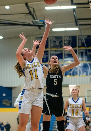 Hutchinson's Mya Thompson (11) shoots past Maize South's Avery Lowe (5) during their game Tuesday at the Salthawk Activity Center. Maize South defeated Hutchinson 41-31.