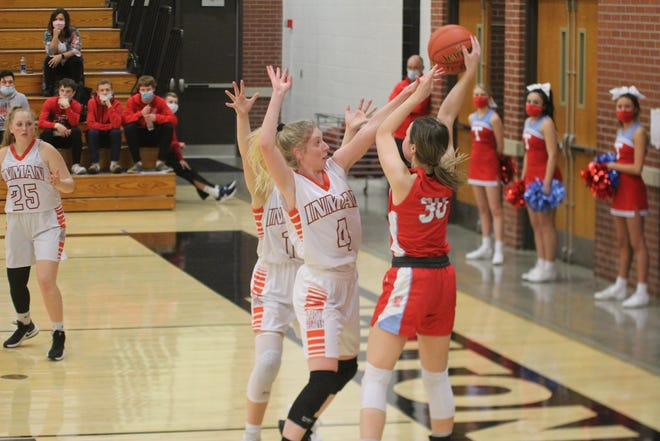 Inman's Lauren Aden guards Trinity's Becca Hammersmith during Tuesday's game. Inman defeated Trinity 49-44.