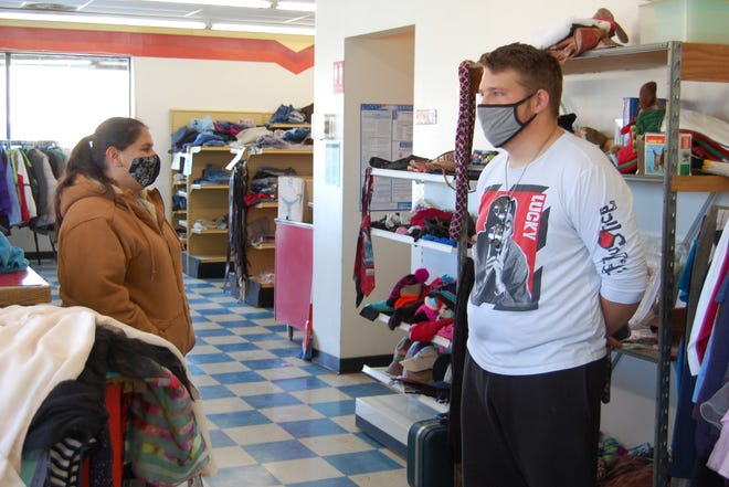Anna Anguiano and Trey McKee, employed through New Beginnings Transitional Jobs Program, were staffing the temporary free clothing store at 800 S. Main on Wednesday.