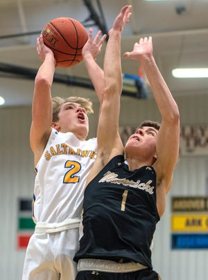 Hutchinson's Jake Huhs (2) shoots over Maize South's Parker Scott (1) during their game Tuesday at the Salthawk Activity Center. Maize South defeated Hutchinson 59-45.