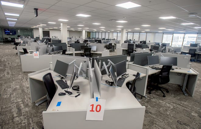Dozens of work stations fill the second floor of the new OSF OnCall building at 330 SW Adams St. in Downtown Peoria. The long-vacant, former Caterpillar Inc. business office is the new headquarters for the OSF HealthCare call center and eICU and Safety Companion programs. About 400 employees will work at the facility.