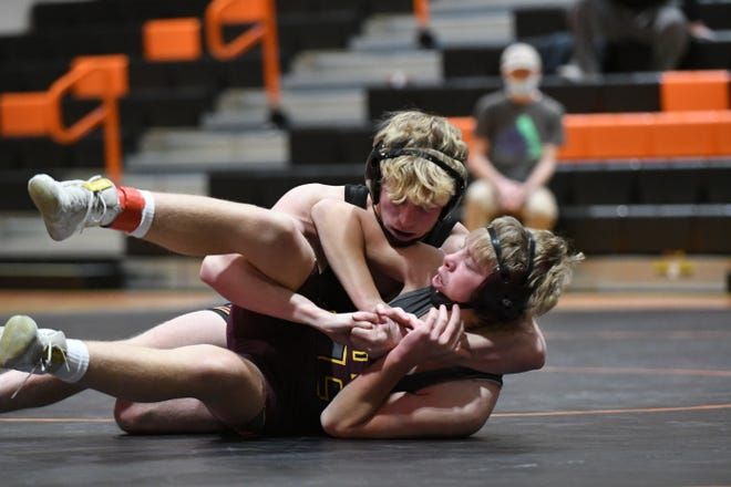 Action from Tuesday's wrestling dual between Kirksville and Davis County