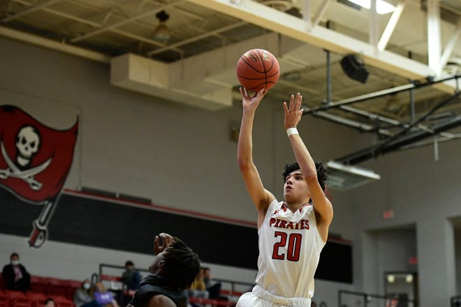 Lubbock-Cooper's Bryan Elliott (20) shoots the ball against Wylie on Tuesday, Jan. 12, 2021, in Woodrow, Texas [Justin Rex/For A-J Media]