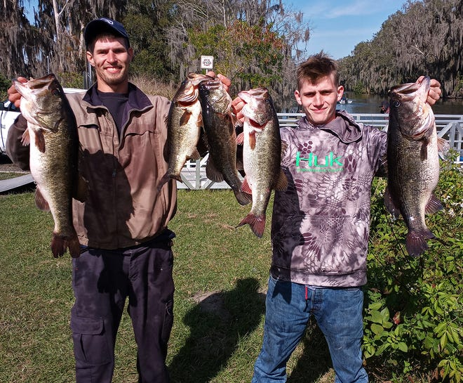Tom Zalys, left, and Caleb Howell had 25.03 pounds and a big bass weighing 8.01 pounds to win the Sunday Open Series tournament Jan. 10 on Lake Hancock.