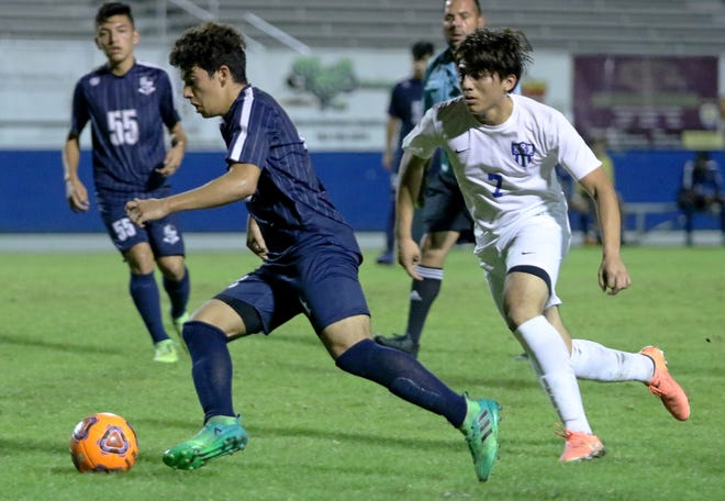 Ridge Community's Thiago Costa dribbles up the field against Mulberry in last season's Champions Cup semfinal match. Costa scored twice against Lakeland Christian in this year's semifinal match.